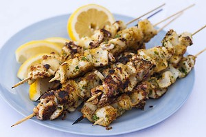 Calamari Skewers with lemon wedges -  Primo Estate
